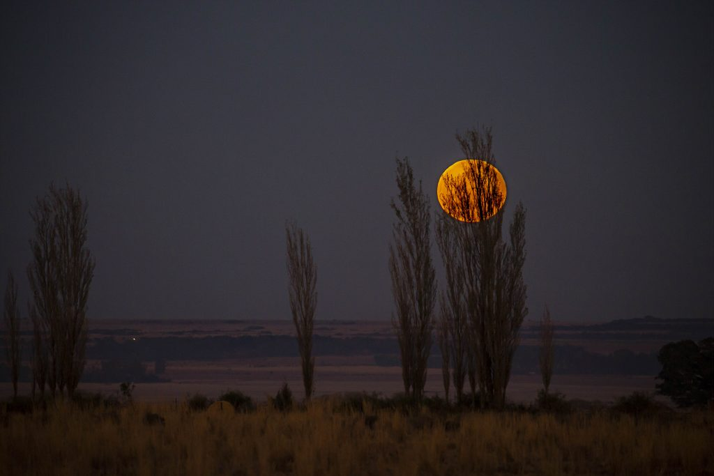 North West morning moon setting